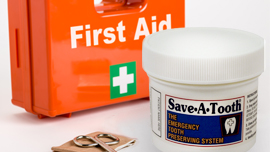 Save-A-Tooth product next to a First Aid kit