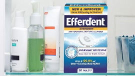 Efferdent product on bathroom shelf