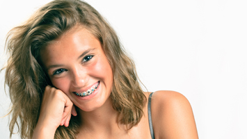 girl smiling and showing her braces