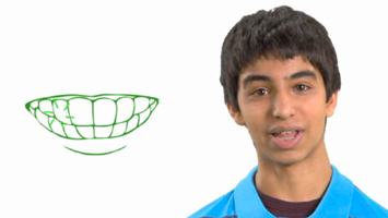 teenage boy next to a drawing of teeth