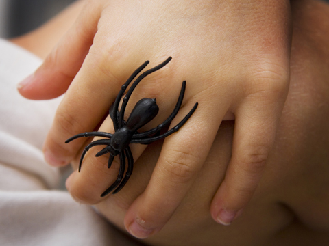 Child wearing spider ring