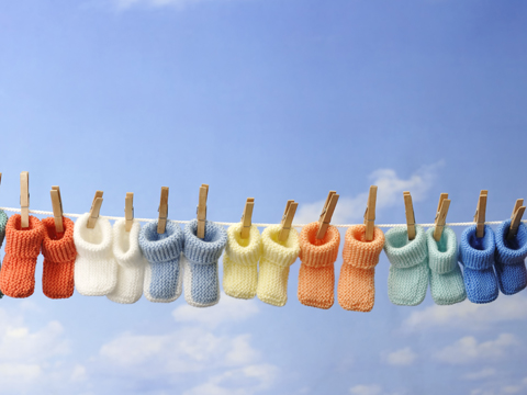 Multiple pairs of colorful baby booties
