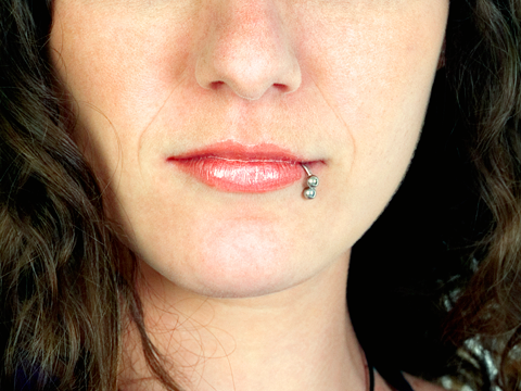 Photo of a woman with lip piercing