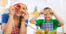 Mother and son have fun with healthy food