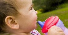 Child holding sippy cup