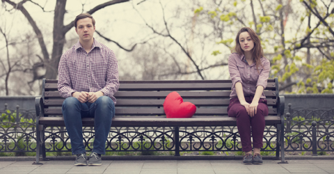 Sad couple on a bench