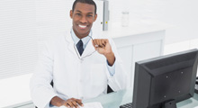 Picture of dentist at a computer