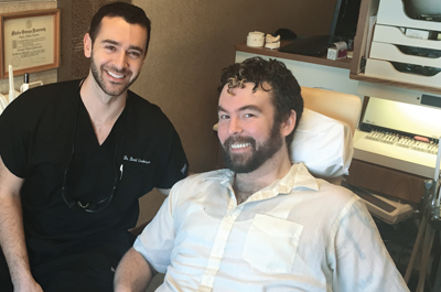 Photo of Dr. David Gershenzon with Donated Dental Services program patient, Jesse