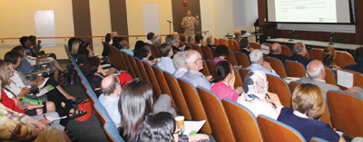 Photo of Dr. James J. Crall in front of a packed lecture hall at the ADA Foundation Caries Symposium.