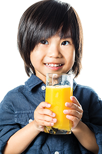 Young Asian boy drinking juice