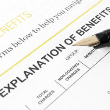 explanation of benefits form with a pen