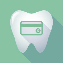 A tooth with a green credit card on a green background