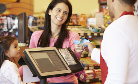 Mother and daughter in the checkout line at the store