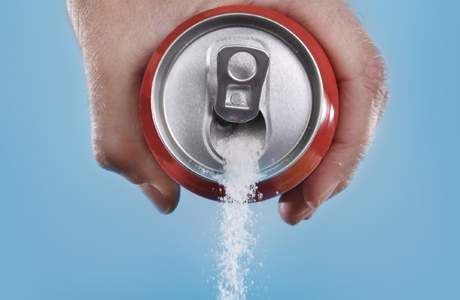 Soda can with sugar pouring out