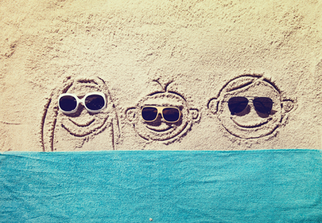 smiling faces in sand