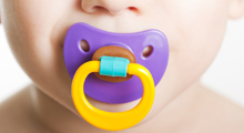 Baby with purple pacifier