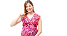 Pregnant woman brushing teeth