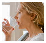 photo of woman drinking a glass of water