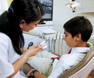dentist with boy patient