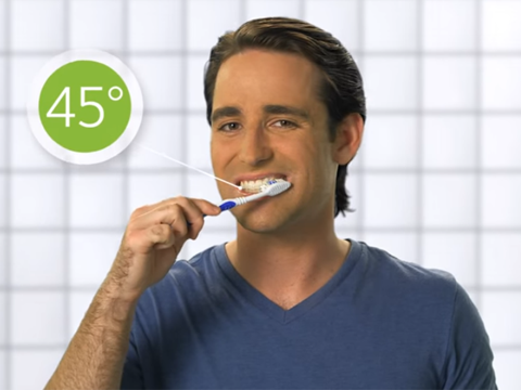 Man demonstrates proper brushing technique