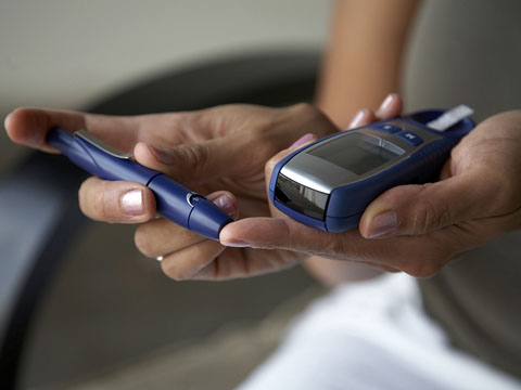 Patient testing blood sugar