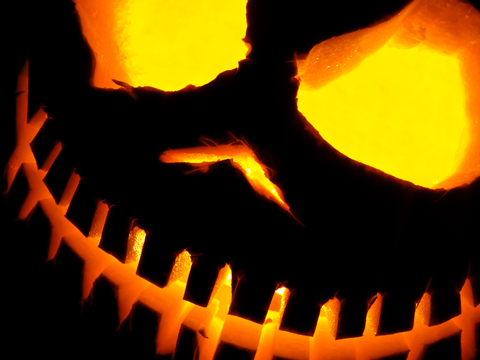 Carved pumpkin lit from within