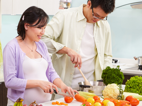 Image of couple cooking healthy food