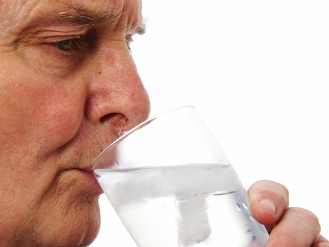 Image of older man drinking water