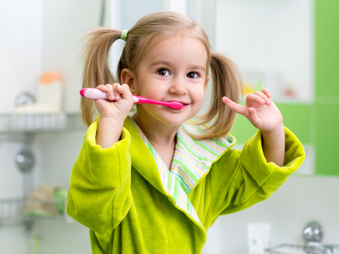 Young Girl Brushing tTeeth