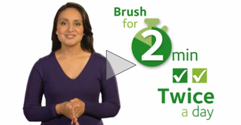 woman talking about brushing for 2 minutes video image
