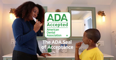 Mother and son brush teeth with Seal of Acceptance products